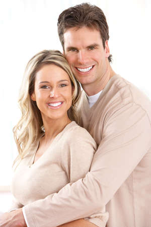 settler: Young happy couple at home