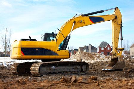 excavate: Yellow excavator, construction.