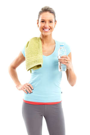 muscularity: Fitness and gym. Smiling young  woman with water. Isolated over white background