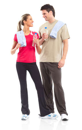 man drinking water: Fitness and gym. Smiling young  strong man and woman. Isolated over white background