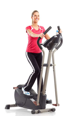 Gym & Fitness. Smiling young woman working out. Isolated over white background Stock Photo - 6423961