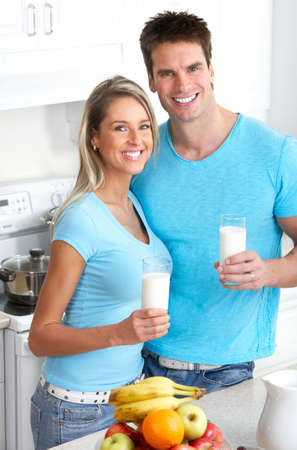 Young smiling couple having lunch at home