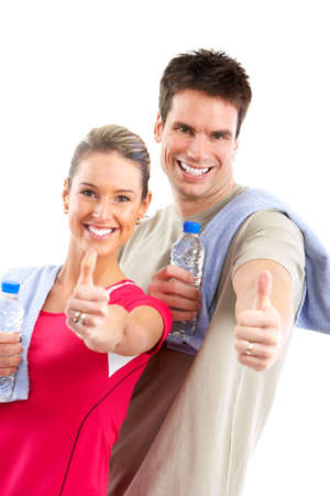 muscularity: Fitness and gym. Smiling young  strong man and woman. Isolated over white background