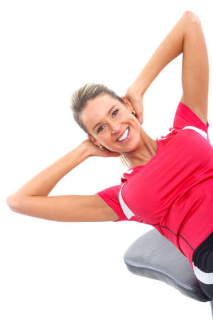 muscularity: Gym & Fitness. Smiling woman working out. Isolated over white background