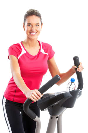 muscularity: Gym & Fitness. Smiling young woman working out. Isolated over white background