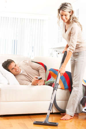 Housework, vacuum cleaner, young couple, home, kitchen Stock Photo - 6424007