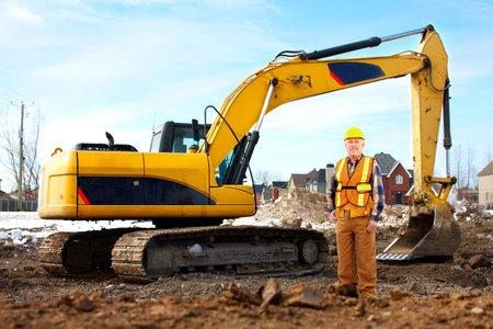 Handsome builder near the excavator
