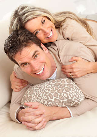 Young happy couple in a bed at home
