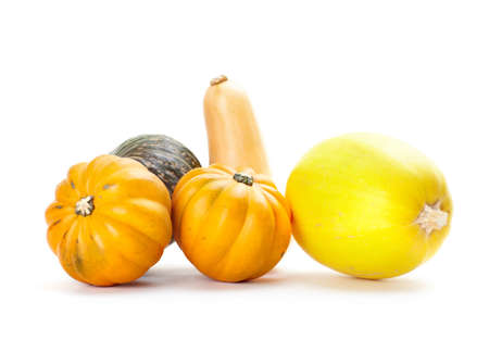 Fresh vegetables pumpkins. Isolated over white background  photo