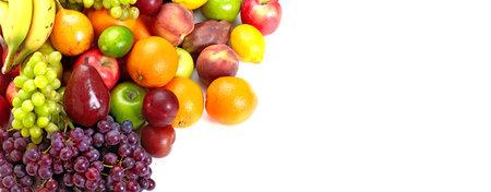 Fresh tropical fruits: banana, orange, apple, grape, peach, lemon, lime. Isolated over white background Stock Photo