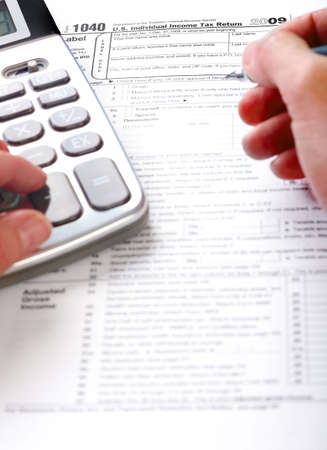 tax form: Filling the Tax Form. Standard US Income Tax Return   Stock Photo