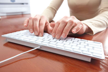 Woman hands typing on the white keyboard  photo