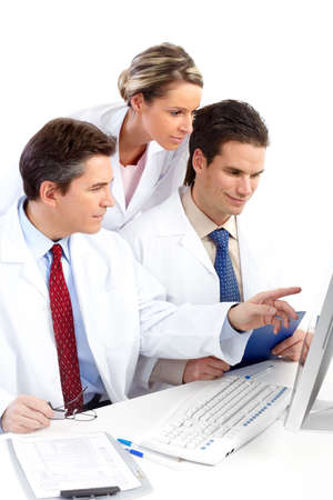 Smiling medical doctors with stethoscopes and computer. Isolated over white background Stock Photo - 6424264