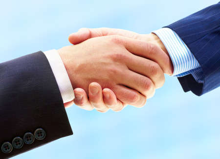Business people. Handshake of businessman. Isolated over white background  photo