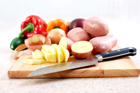 Kitchen, cooking, potato, knife, cutting board, table  photo