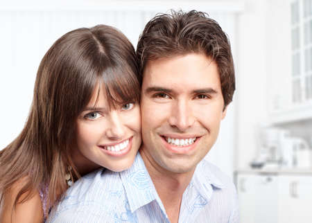 Happy smiling couple in love at kitchen  photo