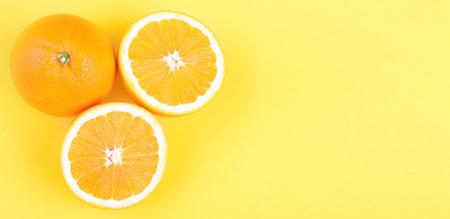 Orange. Over yellow background  photo