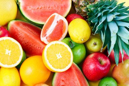 Fresh fruits: watermelon, orange, apple, peach, lemon, lime, ananas.