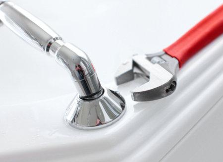 White bath. Wrench. Plumbing. Plumber tool  photo