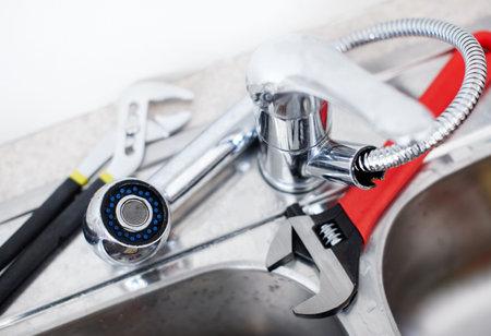 adjustable: Kitchen sink.  Adjustable wrench. Plumbing. Plumber tool