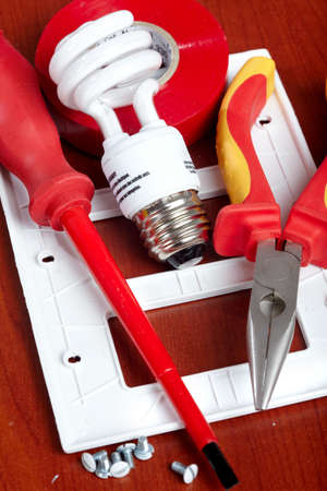 electrical tools, bulbs,  tape, light switch  photo