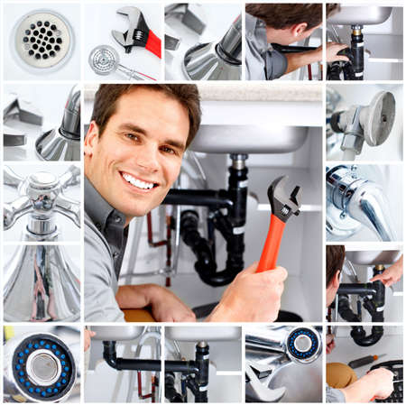 Young plumber fixing a sink Stock Photo - 6485703