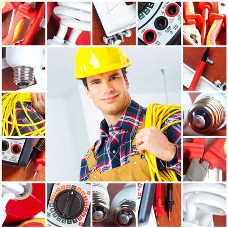 Young smiling builder electrician and set of tools  Imagens