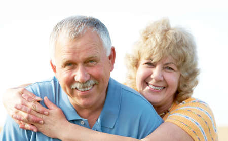 Smiling happy elderly seniors couple outdoor   photo