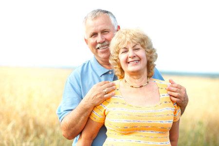 Smiling happy elderly seniors couple outdoor