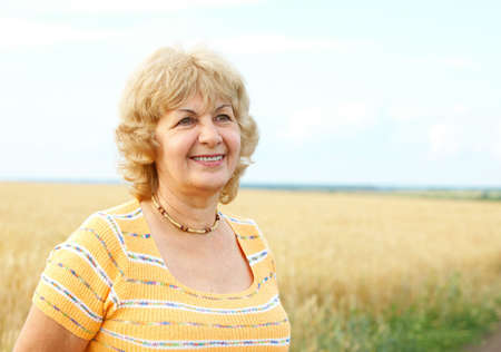 Smiling happy elderly senior  woman   photo