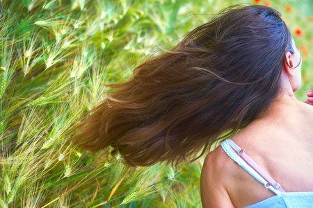 treatment: Woman hair. Treatment. Field. Nature  Stock Photo
