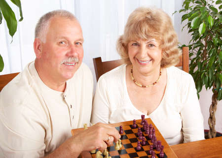Senior couple  playing chess at home Stock Photo - 6538511