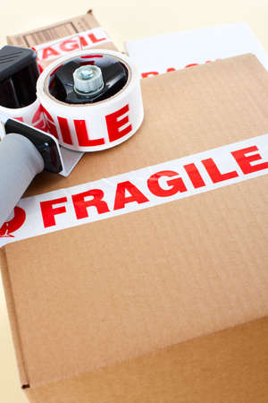 Fragile delivery service. Box, scotch tape, envelops Stock Photo