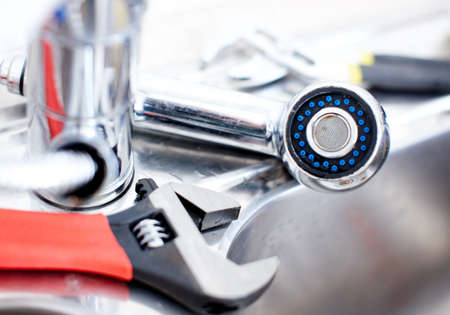 Kitchen sink.  Adjustable wrench. Plumbing. Plumber tool  photo