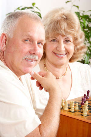 Senior couple  playing chess at home  photo