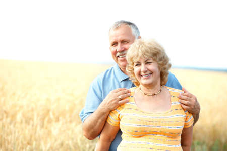 retired: Smiling happy elderly seniors couple outdoor   Stock Photo
