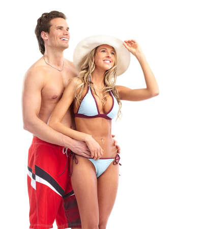 sexy beach girl: Happy smiling couple in swimming suits. Isolated over white background