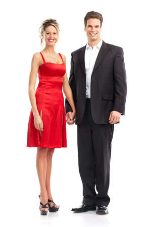 Happy smiling couple in evening dress. Over white background
