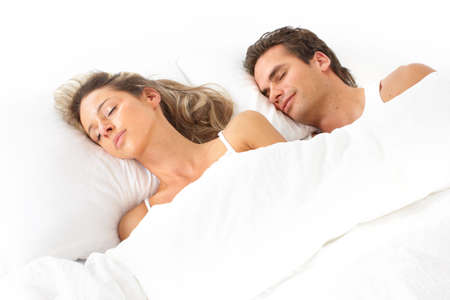 Young happy couple in bed  Stock Photo