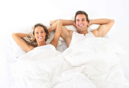 lovers in bed: Young happy couple in bed  Stock Photo