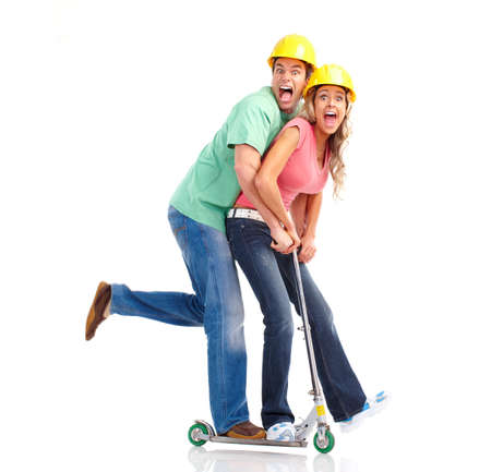 crazy woman: Happy funny couple on a folding scooter  Stock Photo