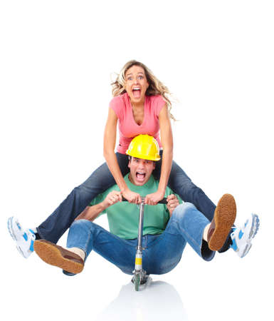 Happy funny couple on a folding scooter  Stock Photo