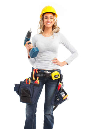 manufactory: Young builder woman. Isolated over white background  Stock Photo