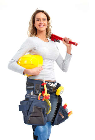Young builder woman. Isolated over white background