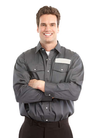Trabajador joven guapo. Aislados sobre fondo blanco