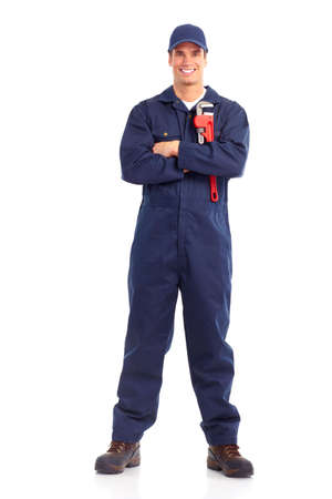 manufactory: Young handsome plumber worker with adjustable wrench. Isolated over white background