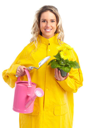 Young smiling florist worker woman. Gardening. Isolated over white background  photo