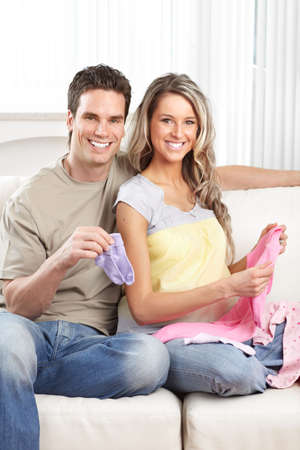 Smiling beautiful pregnant woman and man  at home