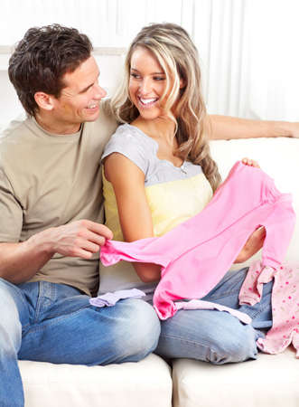 Smiling beautiful pregnant woman and man  at home Stock Photo - 12137515