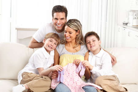 Smiling beautiful pregnant mother and family  at home